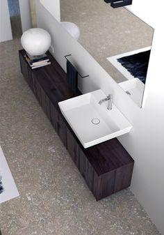 STILO CON leaning #washbasin in Astone®.
