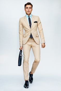 The On Duty Look | GQ | If you're only breaking out your khaki suit for summer weddings, you're doing it wrong. With a dress shirt and a tie, it's a perfect fit for the office, too.