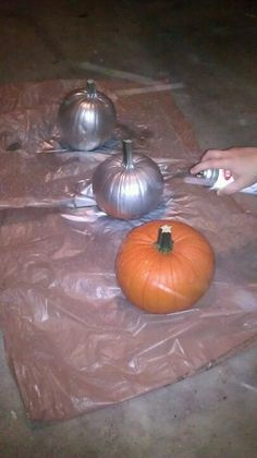 Spray painting pumpkins silver for pretty Cinderella birthday party centerpieces!