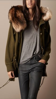 Jacket with faux fur . I'm not sure if it's a collar or part of the hood. Love the green