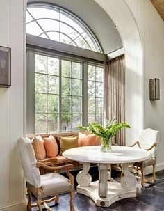 Gorgeous is this kitchen corner with the French dining table, the Belgian bench and dining chairs on a Belgian blue stone floor - Minnie Peters