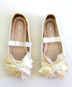 Take a look at this Crème Bow Flat on zulily today!
