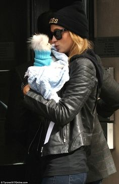 Dog day out: Paris Hilton took her new dog Prince Hilton the Pom out for a walk in New Yor...
