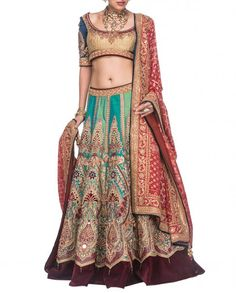 This Bridal lehenga is in silk fabric. Skirt of this lehenga is in 2 aqua colours stripes which have muliticolour hand embroidery on it. The lehenga skirt has w