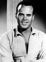 """Banana Boat Song (Day O) was Belofonte's """"signature"""" song. The Banana Boat Song"""" (listed as """"Day O"""" on the original release), reached number five on the pop charts, and featured its signature lyric """"Day-O"""". Hollywood Photo, Vintage Hollywood, Classic Hollywood, Black Is Beautiful, Gorgeous Men, Beautiful People, Top 100 Albums, Calypso Music, Harry Belafonte"""