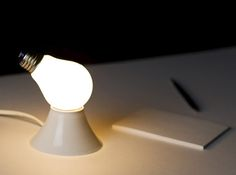 It'shard to thinkof alight source as mundane as thenaked bulb.    In a surprising twist, the Lamp/Lamp gives the lowlylightbulb a new and delightfully absurd personality by simply adding an extra socket.
