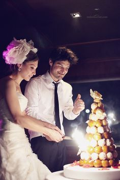 We had a cake like this at my wedding. It's called a Piece Montee and it's really fun when they turn the lights down and light it! A lot like mini-fireworks.