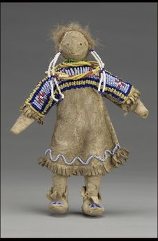 Culture/People:Sioux Object name:Female doll Date created:circa 1890 Place:Plains; USA, Canada (inferred) Media/Materials:Deerhide/deerskin, glass bead/beads, sinew, paint, buffalo hair Techniques:Sewn, lazy/lane stitch beadwork Collection History/Provenance:Collection history unknown; formerly in the collection of Joseph W. Keppler (1872-1956, long-time friend of George Heye); acquired by Heye in 1906. NMAI Catalog number:8836