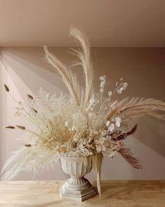Dramatic dried flower arrangement in roman vase Dried Flower Arrangements, Floral Centerpieces, Flower Vases, Dried Flowers, Flower Art, Winter Floral Arrangements, Flower Bouquet Wedding, Floral Wedding, Grass Decor