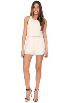 Beige chiffon racerback romper featuring a drawstring waist and zipper closure down the back. This romper is the perfect year-long addition to your wardrobe. Dress it up or down for any event!