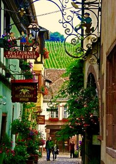 Joseph Abhar - Colmar , Alsace, France capital of Alsatian wine!! Amazing shopping and dining lane while enjoying the incredible winery in background!!