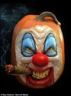 Everybody loves a cute clown! A clown face carved out of a pumpkin by Ray Villafane and his team for Halloween