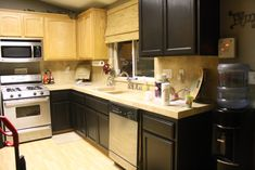 oak cabinets repainted black | Painting Oak Kitchen Cabinets Black Pictures