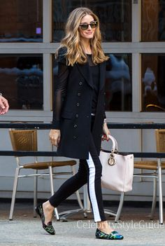 Seen on Celebrity Style Guide: Olivia Palermo wore black white stripe tuxedo pants when she and boyfriend Johannes Huebl went out for a stroll in New York City, New York on March 31.... Get It Here: http://rstyle.me/n/hiy46mxbn