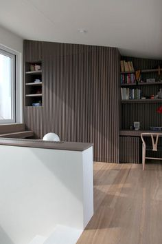 Choosing Engineered or Solid Wood Flooring with Reasons: Extraordinary Brown Varnished Wooden Shelf With Wall Paneling Near Glass Window On Wooden Floor Astounding Simplistic Contemporary Penthouse Design Ideas Glass Walls ~ workdon.com Flooring Inspiration