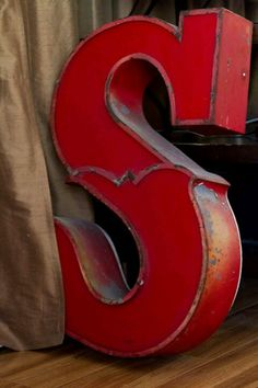 How cool would an old two-toned metal letter in a circus or carnival font be for décor á la alphabet?!