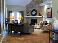 @April Cochran-Smith Newman Very close to the set up of your living room. Fireplace in corner and door to patio. I would put the sofa close to the wall. Love the table and lamps behind to sofa. And LOVE the stone fireplace!! Plus this gives a good idea for what to do with the wall space beside the fireplace.