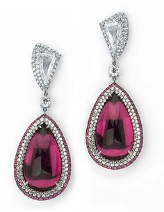 """Cabochon rubellite and diamond earrings by Martin Katz in white gold, set with two pear-shaped rubelites (22.58ct) and two """"fang""""-shaped dia..."""