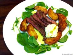 Grilled skirt steak with horseradish sauce, roasted potatoes, and upland cress