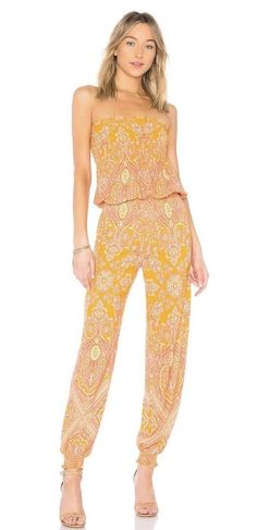 1ed26f80b0f NWT Free People Thinking Of You Smocked Strapless Jumper Jumpsuit Yellow  Combo M