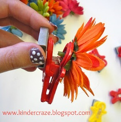 DIY magnetic flower clip using a magnet man and artificial flower can use as a way to brighten up a whiteboard or chalkboard in a classroom!