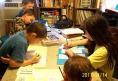 Working diligently on their Animal Classification lapbooks from In the Hands of a Child!