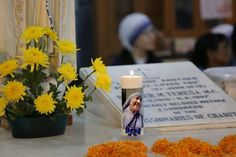 Nuns take part in a mass prayer in front of the Mother Teresa's tomb at Mother House in Calcutta