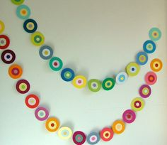 paint chip swag made from punching different sizes of circles from upcycled paint chips. Glue together and then to string...4