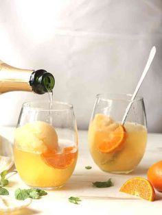These are so fun! Champagne Floats have all the flavor of a classic Mimosa, but with a little something extra perfect for a brunch party | Completely Delicious