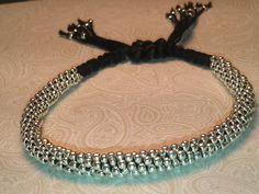 I am loving Kumihimo!  This is my knock-off of a Neiman Marcus Caviar bracelet  for a fraction of the price...I used a macrame slip knot and 11/0 seed beads on #8 pearl cotton. It is very comfortable :)
