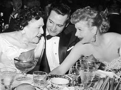 Louella Parsons steals a moment with television's golden couple, I Love Lucy's Desi Arnez and Lucille Ball, in 1958.