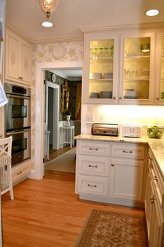 .Wall paper & inside cabinets.  Lighted upper cabinets w/ glass fronts.