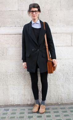 long black blazer, collared shirt and brown satchel.