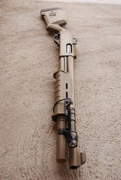 870 in Magpul FDE furniture and Cerakote with tactical ring sights and rail.