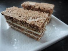 A delicious simple Sunday dessert: Thin layers of walnut cake filled with vanila butter cream