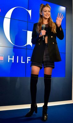 12 October Gigi Hadid was in Tokyo for the launch of her Tommy Hilfiger collection. She teamed shorts and a blazer with thigh-high socks for the occasion.