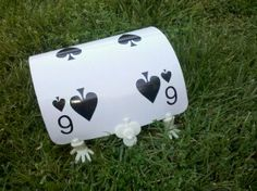 I can print and laminate a large playing card....and secure it to the wickets that come in the croquet set!