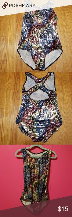 """🤸🏼♀️NWOT Balera Gymnastics Leotard🤸🏾♀️ NEW BALERA GYMNASTICS LEO in metallic rainbow animal print with keyhole back. This loe has never been worn but was washed one time in hopes that it might shrink up enough for my daughter to wear it. The size is a Child Large but runs bigger than that. Shoulder to crotch measures 21.5"""" unstretched. Top of leg openings (hips) measures 14"""" across. Back across shoulder blades measures 12.5"""" across. Cute leo other than being too big for my gymnast…"""