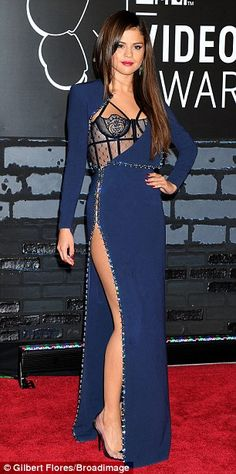 Revealing her wild side: The former Disney star showed off her figure in the daring gown