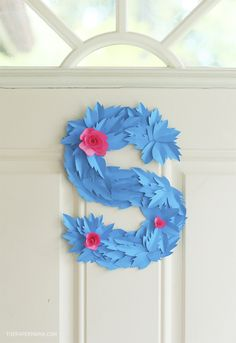 Get your door ready for summer! Create a #DIY floral #monogram wreath from @thepapermama. #HPCreate