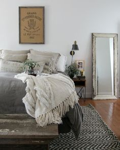 Modern Farmhouse Bedroom - simple furnishings, natural materials and muted colors - via Jeanne Oliver Designs