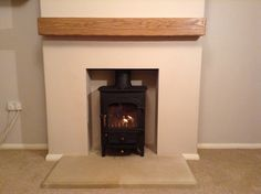 Clearview Pioneer 400 in black metallic with Bathstone hearth and floating oak mantle shelf. A total transformation to the lounge of this bungalow in Ash Vale, Hampshire.