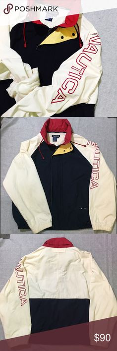 Men's - Vintage Nautica Spell Out Jacket Another classic retro circa 1990's. Large spell out Nautica embroidered left sleeve. Drawstring rain hood hidden in collar.  Slight yellowing on sleeve due to age (I mean, it is 20+ years old!) Other than, it's in really good condition. Nautica Jackets & Coats