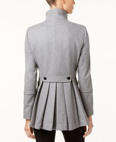 Calvin Klein Stand-Collar Skirted Walker Coat $289.99 Style that perfect look for a night out on the town with this wool-blend walker coat from Calvin Klein.