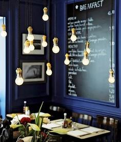 blue wall, multiple hanging brass bulbs