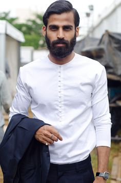 Simple white shirt with delicate buttons // Pranav Kirti Misra - Designer at Huemn,