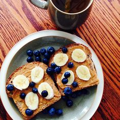 Breakfast this morning was 2 slices of chia flax bread with @peanutbutterco Mighty Maple peanut butter and banana slices with blueberries most classic and favourite breakfast ever