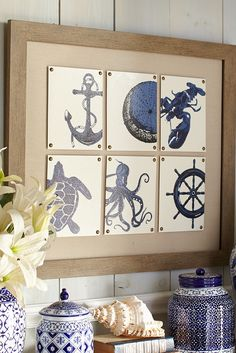 A collage of indigo nautical motifs on glass tiles in Pier 1's Sea Life Framed Art creates a new seafaring icon in your living or family room. Handsomely framed in iron with a weathered patina, this is the perfect accent to any nautically themed space.
