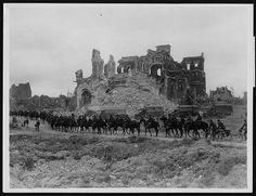 British cavalry passing the ruins of Albert cathedral, France, during WW1.There…