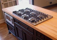 Custom Maple Wood Countertop with gas stove insert by Grothouse